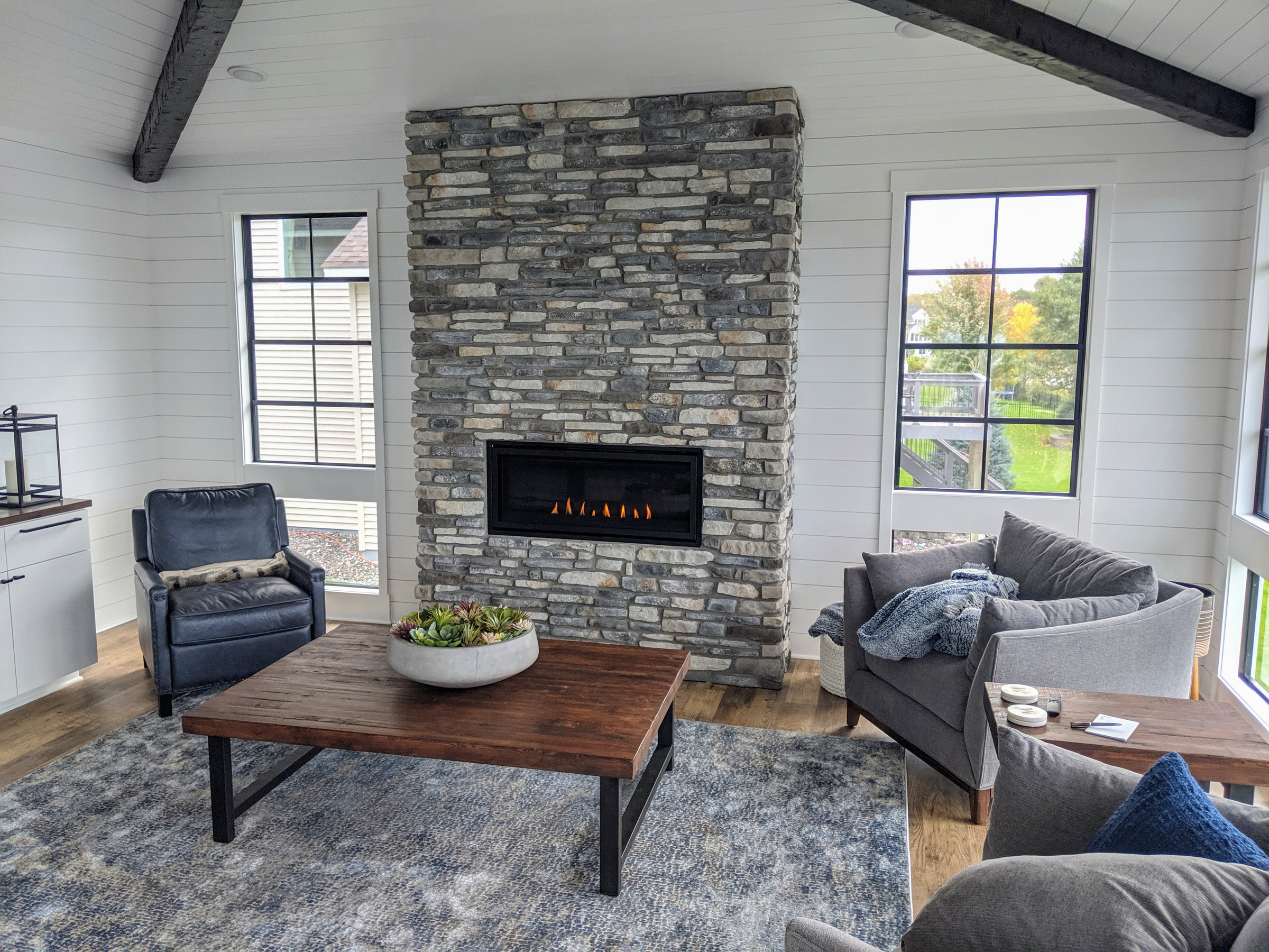 Cosmo 42″ fireplace w/ floor to ceiling stone & 18″ returns