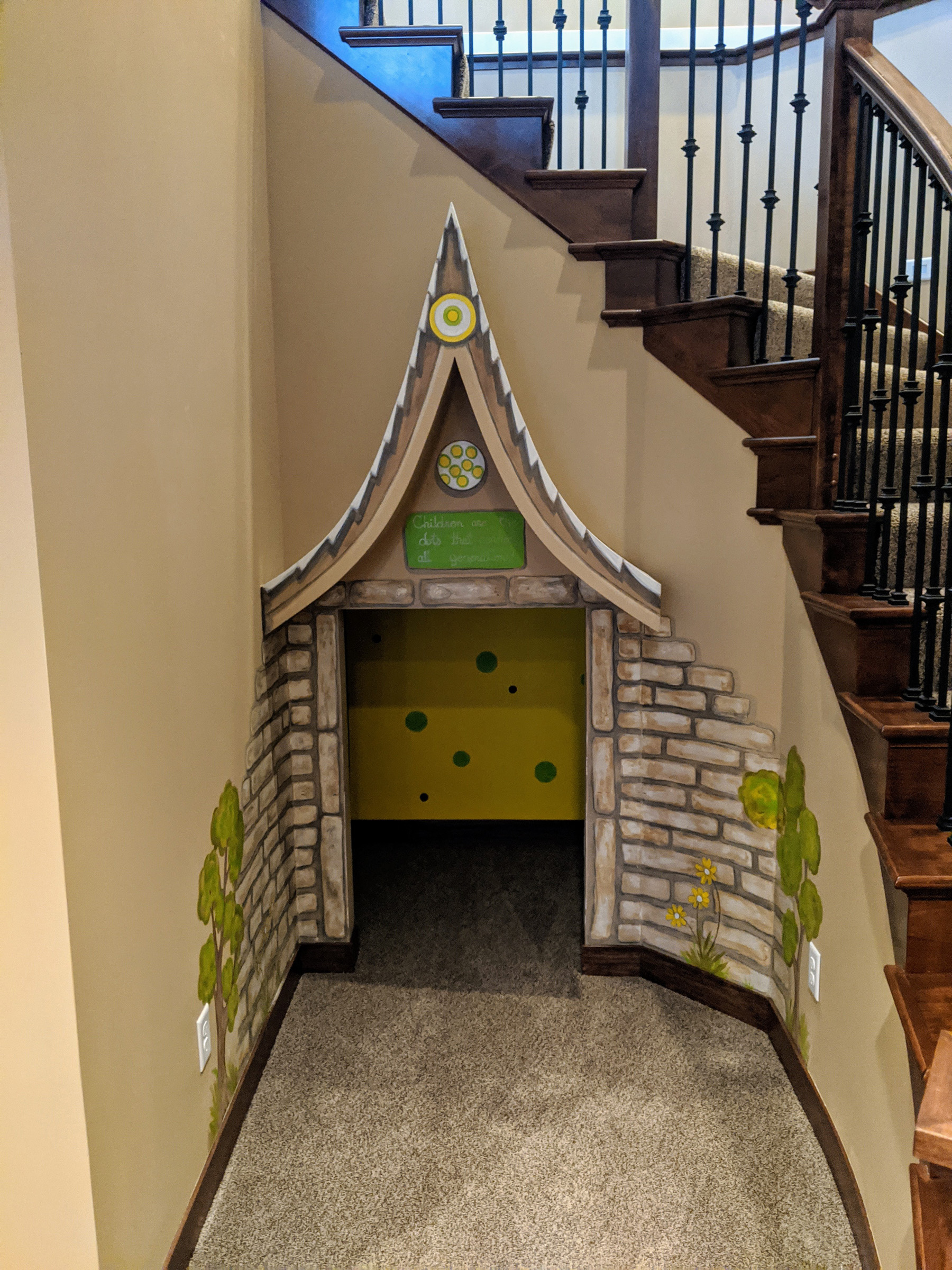 Lower Level Kids Play Room Under Stairs
