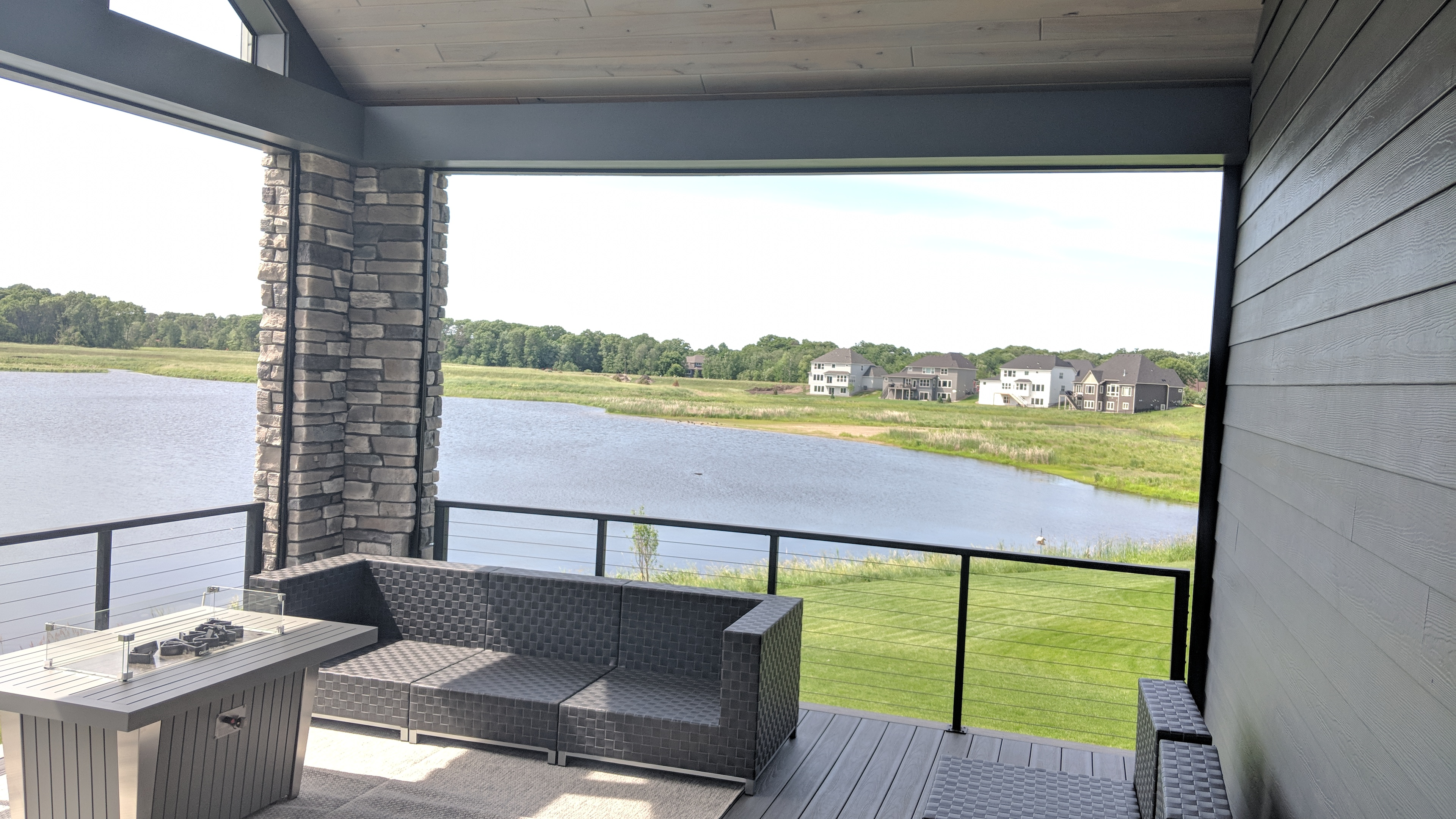 Screen Porch Stone Columns Covered Deck With Motion